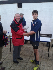 Captain Ben Brownhall receives the U16 Hampshire Bowl