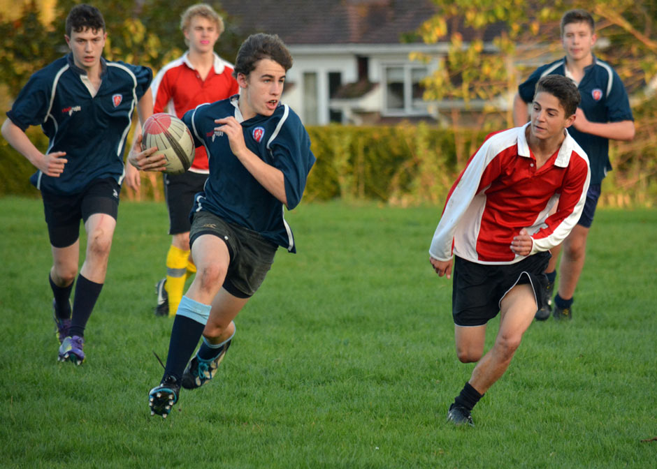 Flanker James Robinson carries the ball forward, supported by Kieran McCauley, in their win against Westgate School.