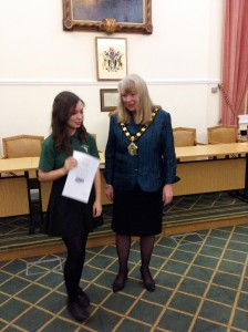 Rebecca Bowyer being presented with a Merit Certificate