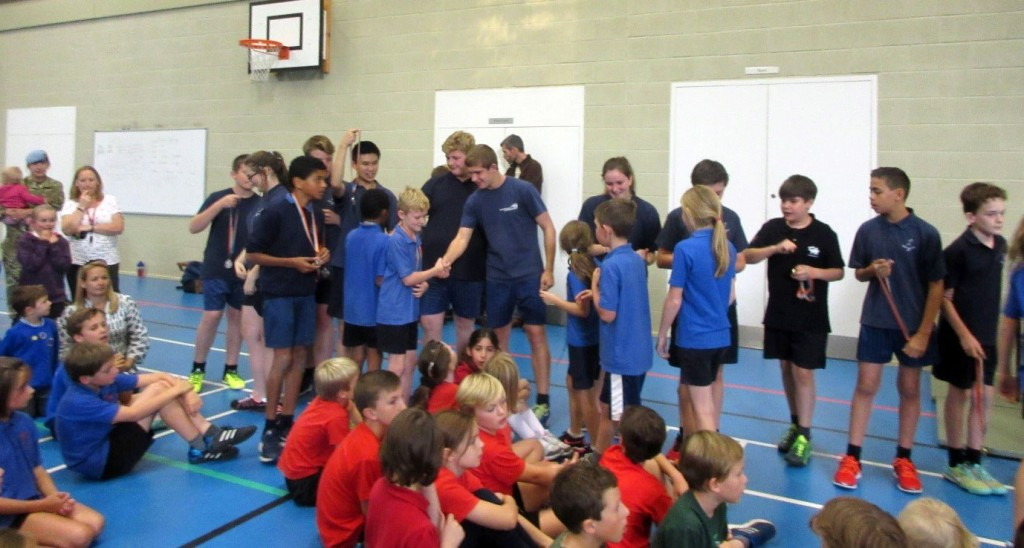 The Young Sports Leaders presented the gold and silver medal winners to the competitors and congratulated them for doing so well.