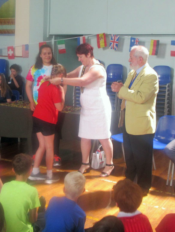 The Mayor of Test Valley presenting a medal with the Mayor of Romsey